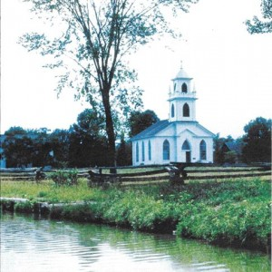 Image of an abandoned church by a body of water...to accompany a poem about a church that was closed.