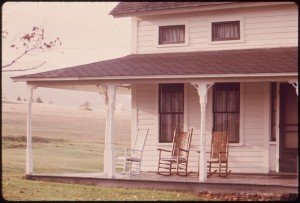800px-EMPTY_ROCKING_CHAIRS_ON_AN_OLD_FARMHOUSE_PORCH_ON_ROUTE_73_-_NARA_-_554697